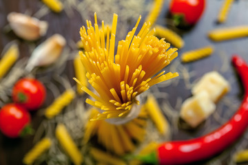 Pasta with ingredients on table, top view macro shot