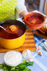 Traditional Russian hot soup with meat, beetroot and cabbage