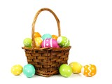 Fototapety Easter basket filled with colorful eggs on a white background