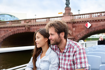 Couple travel in Berlin sightseeing on boat tour