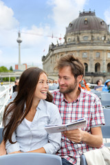 Tourists couple reading travel book on Berlin boat