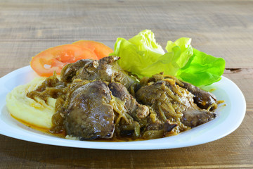 Pan fried chicken liver with onions