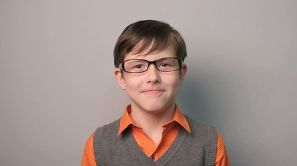 teenager boy funny laughs threw back his head with glasses ten