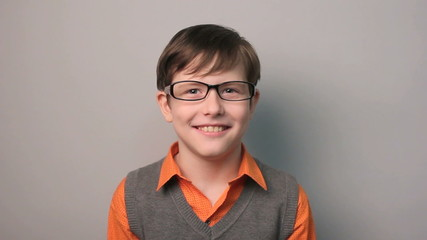 teenager boy funny laughs threw back a his head with glasses ten