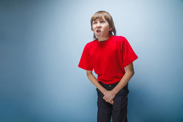 Boy, teenager, twelve years in  red shirt wants to use  toilet,