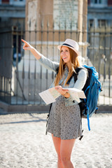 happy exchange student girl visiting Madrid city reading map