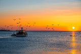 Fising boat on sunset