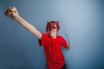 Boy teenager twelve years in  red shirt in  mask, super hero
