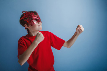 Boy teenager twelve years in  red shirt in the mask, super hero