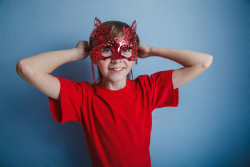 Boy teenager twelve years in the red shirt in the mask, super he