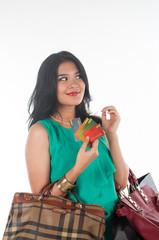 Shopaholic girl spending her money for branded item
