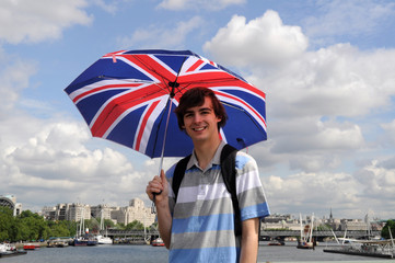 Tourist with British flag umbrella in Southbank, London