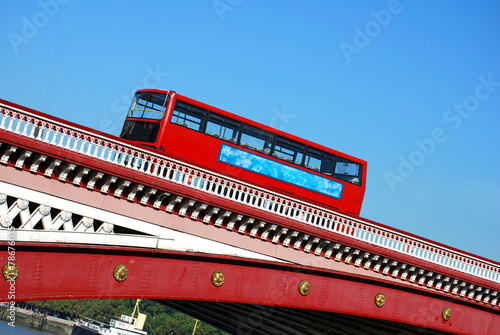 Red double decker bus on Blackfriars bridge in London