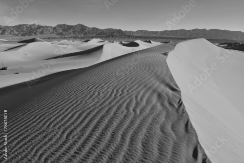 Desert landscape with sand dunes and mountains