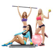 Charming young women posing with sports equipment