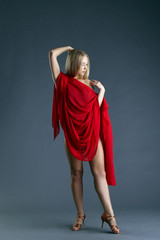 Leggy nude dancer posing with red cloth