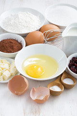 fresh ingredients for baking on a white table, vertical