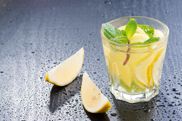 Fresh lemonade with mint on a dark background