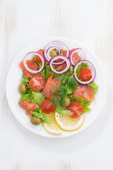 fresh salad with salted salmon, top view, vertical
