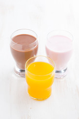 orange juice, chocolate milk and fruit yoghurt, vertical