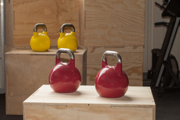 colorful kettlebells on cross fit boxes