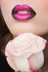 Woman face with lilac Lips and Rose Flower.