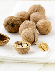 natural organic walnuts on a wooden table