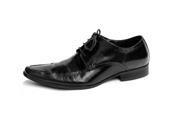 Single black leather shoe