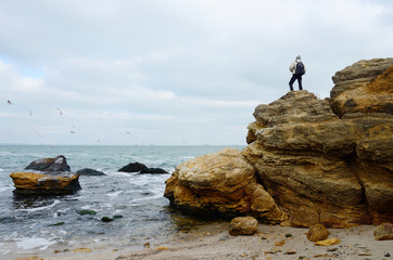 Traveller standing on the top of limestone rock,Odessa,Black Sea