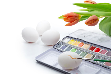 painting Easter eggs with watercolor isolated on white, corner b