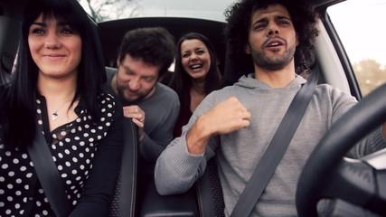 Friends in car having lot of fun