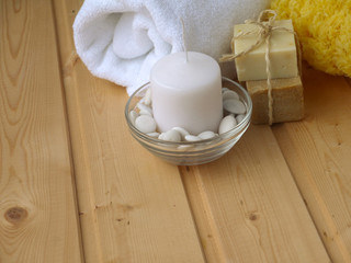 Towel,soap,candle and sponge on the wooden background