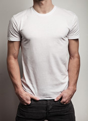 White blank t-shirt on a young man isolated, front