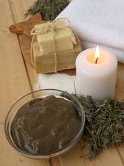 Mud,candle,dry lavender and soap on the wooden background