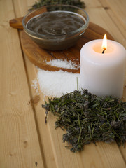 Mud,salt,candle and dry lavender on the wooden background