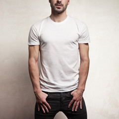 White blank t-shirt on handsome athletic man
