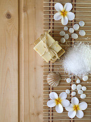 Soap,shell,stones and tiare flowers on the wooden background