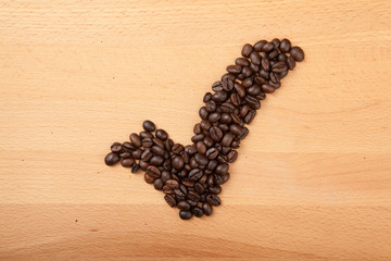Roasted coffee beans in check mark shape