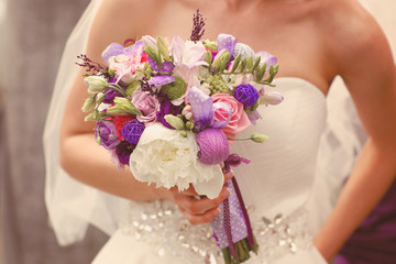 Wedding bouquet in the hands of a bride