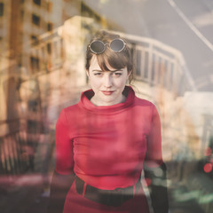 double exposure of beautiful red dressed young woman in the city