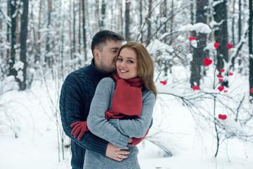 Portrait of happy couple in winter park