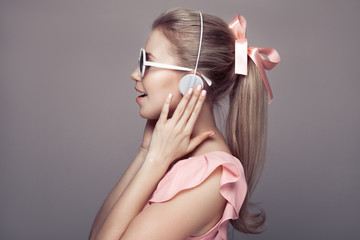 Girl with headphones listening music and have fun.
