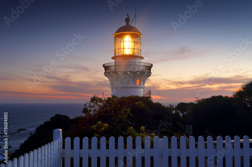 Fotobehang Vuurtoren / Mill Sugarloaf Point Lighthouse at sundown