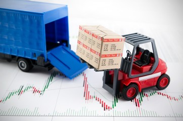 Forklift truck toys with boxes. Concept of international freight