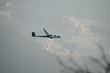 Segelflugzeug über winterlicher Landschaft - 78685899
