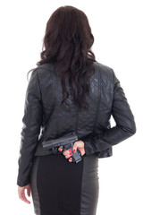 woman hiding gun behind her back isolated on white