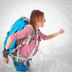 backpacker running fast over white background