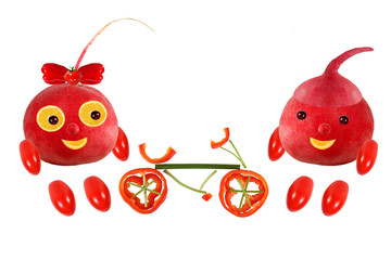 Two funny little radish standing with bicycle. The picture is ma