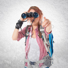 girl looking through binoculars over white background