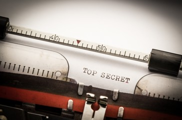 Top secret text on typewriter